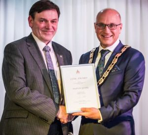 Andrerw receiving his award from Cllr Charles Goldstein, Mayour of Hertsmere Borough Council 2017-18