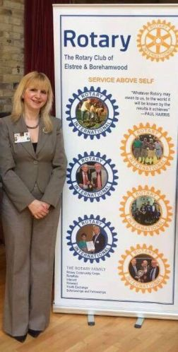 Lisa Rutter with E&B Rotary Club banner